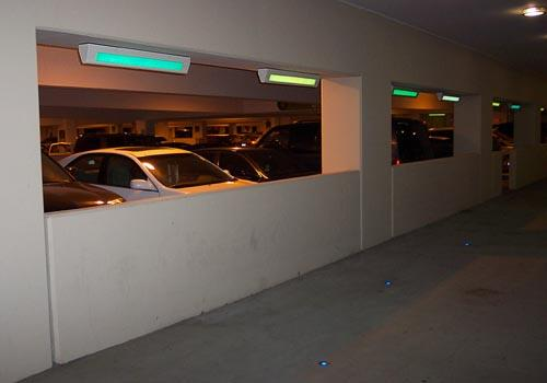 Astro XL2 Series ceiling mounted for downward light distribution along parking garage walkway.