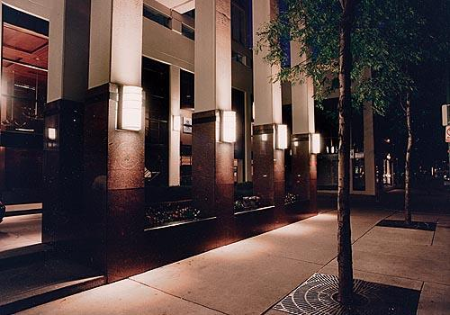 A row of Mariner Series illuminated & mounted along the front pillars and entrance walls of a building in downtown Chicago.