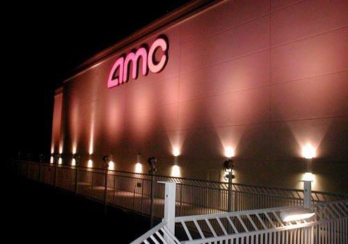Row of Comet Series illuminated & mounted alongside a railing of the AMC building.