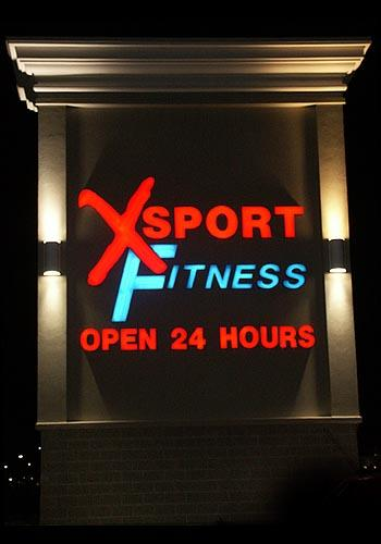 Pair of Comet Series illuminated & mounted on X-Sport Fitness Tower shot from the front.