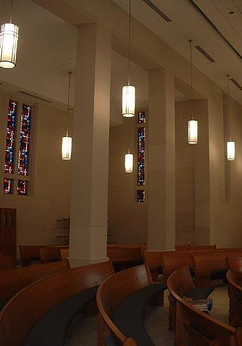 Side row of Galileo Pendant Series illuminated & ceiling suspended in the chapel at St. Ambrose Church under construction.