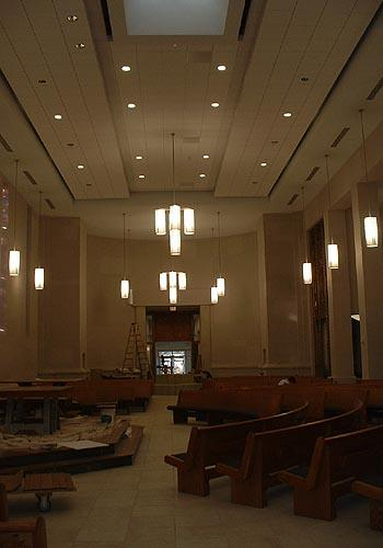 Entry way view of Galileo Pendant Series illuminated & ceiling suspended in the chapel at St. Ambrose Church under construction.